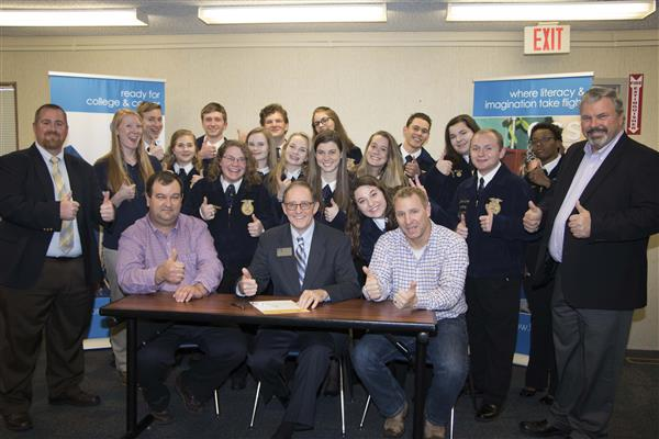 FFA students and staff give thumbs up with Dr. Ron Singletary