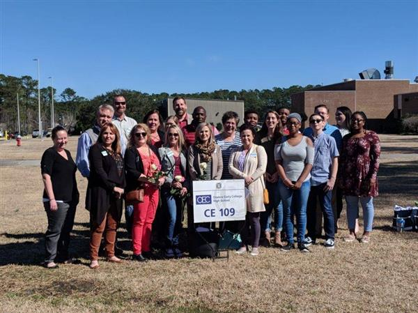 The Jacksonville-Onslow Chamber Leadership class poses with OEC students at CCCC